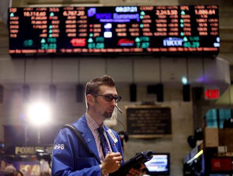A trader on the floor at the New York Stock Exchange in New York, Thursday, May 27, 2010. (AP)