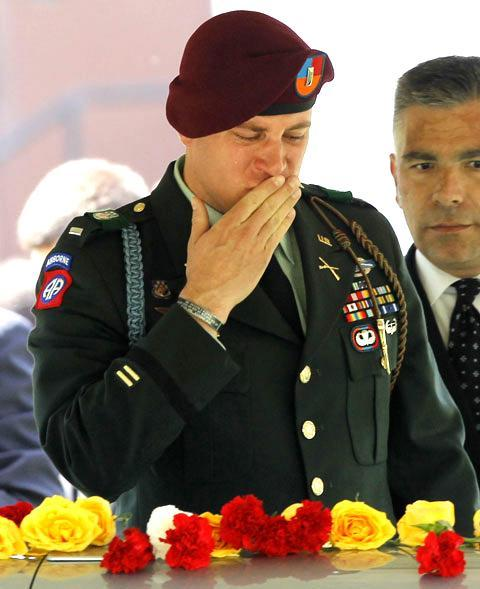 U.S. Army 1st Lt. James Rathmann says farewell to his best friend and fellow 1st Lt. Salvatore Corma during a burial in West Point, N.Y., on May 13, 2010. Corma died April 29 in Afghanistan. (AP)