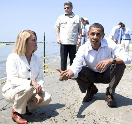 President Barack Obama, right, and LaFourche Parish president Charlotte Randolph take a tour of areas impacted by the Gulf Coast oil spill on Friday, May 28, 2010 in Port Fourchon, La. (AP)