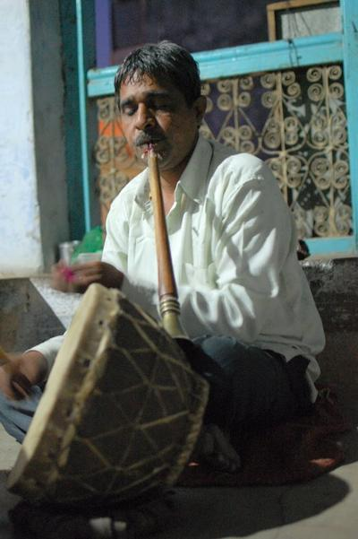 Sheru Mayuddin plays an oboe-like instrument called the Shehnai and the drums as he waits for his nephew to take over the drums. (Jill Ryan)
