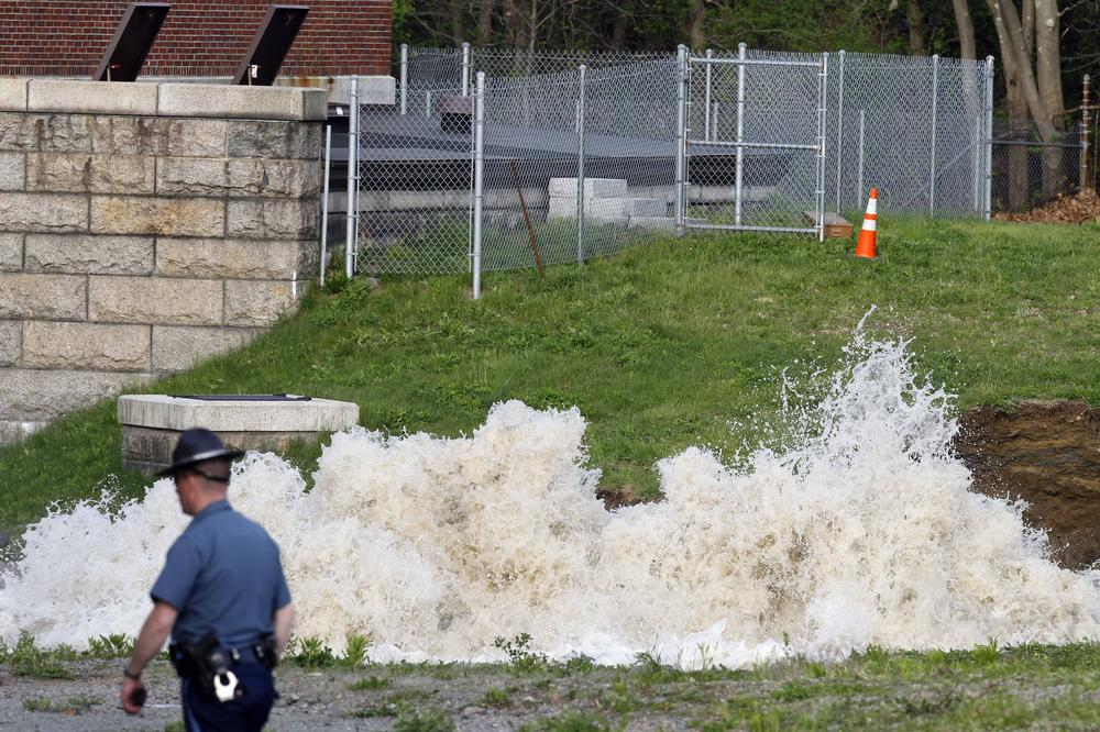 Water surges from the ground at the site of a water main break, Saturday, May 1, 2010, in Weston, Mass. Water to 2 million people in Boston and more than two dozen suburbs is temporarily unsuitable for drinking after the break in a pipe that connects a major suburban reservoir to the city. (AP)