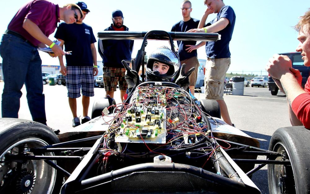 University of Manitoba student Christian Fay, 22, sits behind the wheel of the school's formula hybrid racing car at the fourth-Annual Formula Hybrid International Competition at the New Hampshire Motor Speedway in Loudon, N.H., Wednesday, May 5, 2010. (AP Photo)