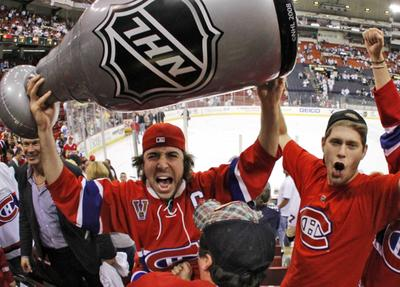 Montreal Canadiens fans celebrate the team's 5-2 win over the Pittsburgh Penguins in Game 7 on Wednesday. (AP Photo/Gene J. Puskar)