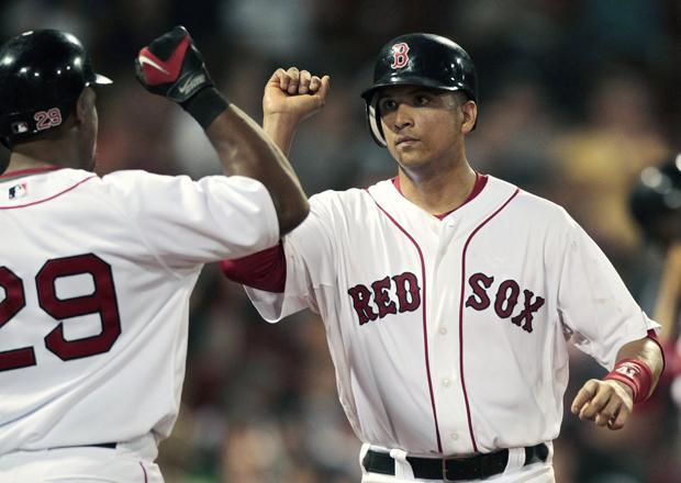 Boston's Victor Martinez celebrates with Adrian Beltre after scoring on a single by Kevin Youkilis in the eighth inning of a the game against Oakland on Tuesday in Boston. Boston won 9-4. (AP)