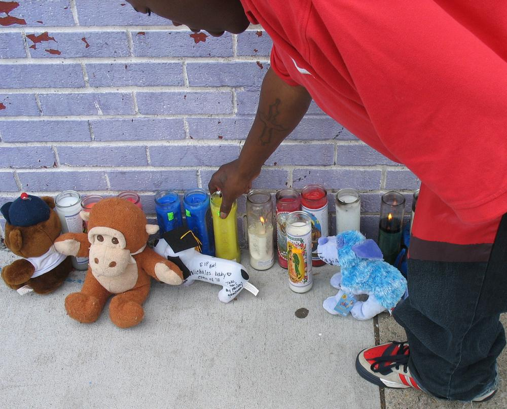 Candles and mementos were left at a makeshift shrine for Nicholas Fomby-Davis in Dorchester. (Bianca Vasquez-Toness/ WBUR)
