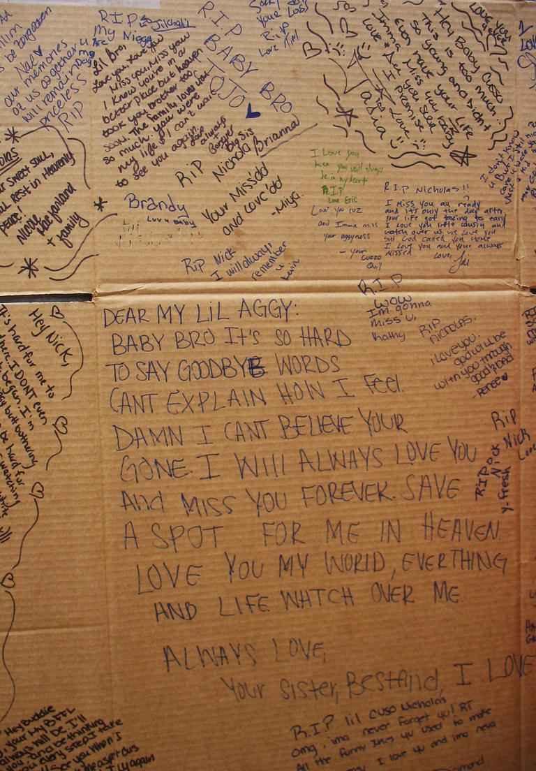 Friends and family of Nicholas Fomby-Davis wrote goodbyes to him on a flattened cardboard box. Click to enlarge. (Bianca Vazquez-Toness/WBUR)