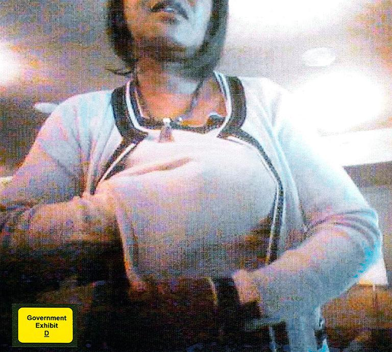 This screenshot allegedly shows former state Sen. Dianne Wilkerson, D-Boston, stuffing bribe money under her sweater on June 18, 2007, at No. 9 Park restaurant in Boston. (AP/U.S. Attorney's Office)