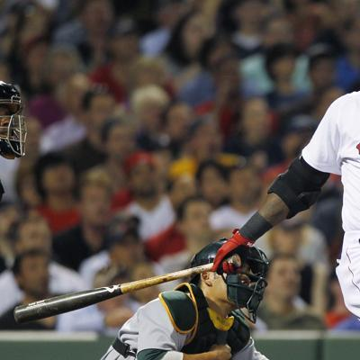Boston designated hitter David Ortiz watches the flight of his two-run home run off Oakland pitcher Ben Sheets during the fifth inning of the game in Boston on Wednesday.(AP)