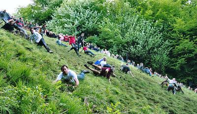 Revelers tumble down Cooper's Hill in Gloucester, England during the 2006 race. (mike warren/Flickr)