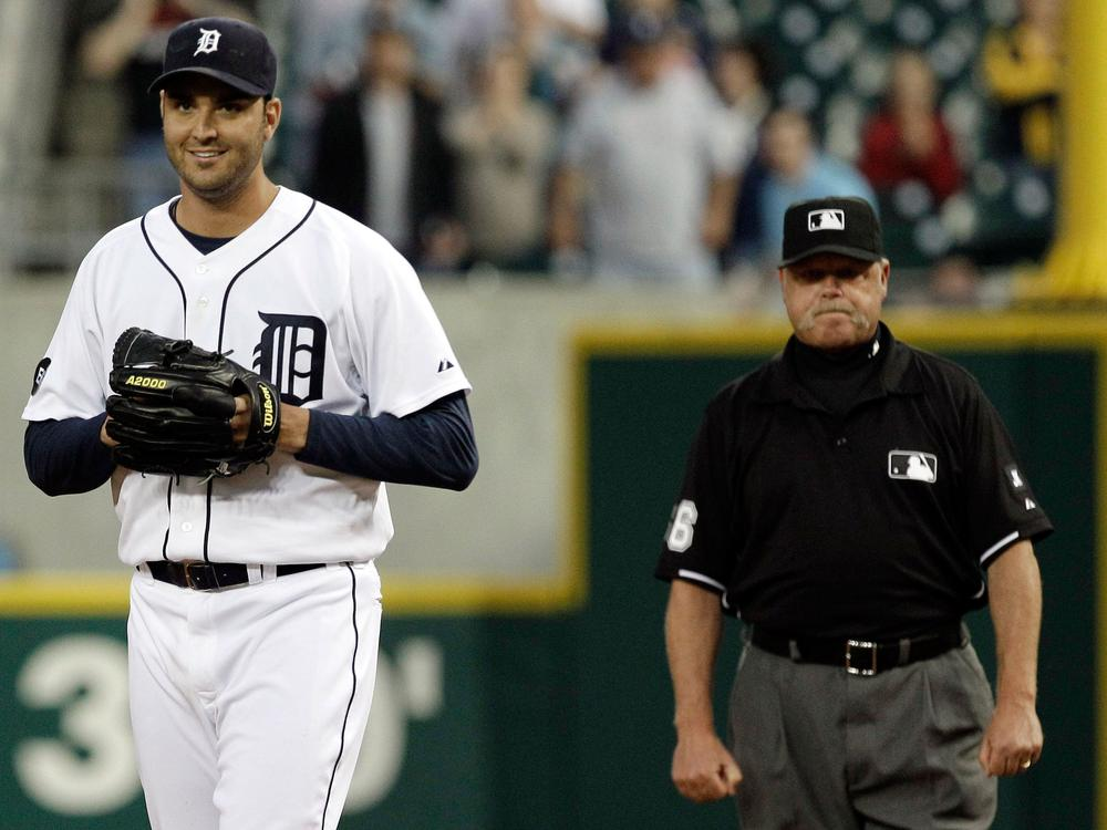 Detroit Tigers pitcher Armando Galarraga walks away from first base umpire Jim Joyce, who called Cleveland Indian Jason Donald safe Wednesday. The highly contested call resulted in Galarraga's loss of a perfect game. (AP)