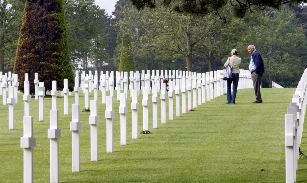 Visitors walk among the graves at the Colleville US cemetery, western France, Sunday  on the 66th anniversary of the D-Day. (AP Photo/Remy de la Mauviniere)
