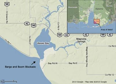 This Google map shows the 600-foot mouth of Weeks Bay near Magnolia Springs, Ala.  Residents have put barges with booms in place to prevent oil from crossing into the bay.