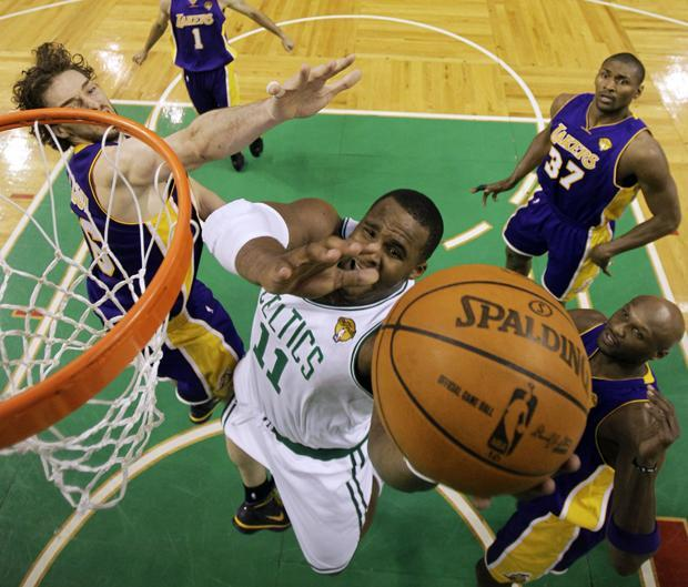 Boston forward Glen Davis drives between Los Angeles' Pau Gasol,  Ron Artest and Lamar Odom during Game 3 of the NBA finals on Tuesday in Boston. The Lakers won 91-84. (AP)