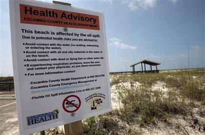 Health advisory signs were posted at the entrance to Perdido Key, Fla., beaches after oil began washing up. (AP)