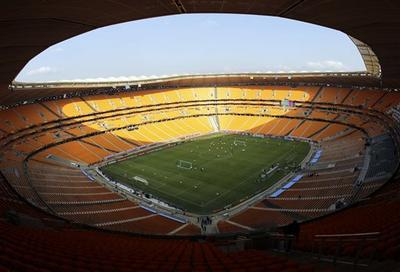 South Africa practices before an empty stadium during the final training session for the soccer World Cup. (AP)