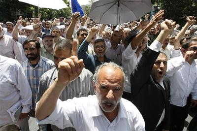 Iranian worshippers chant pro-government slogans after Friday prayers in Tehran on June 11, 2010. (AP)