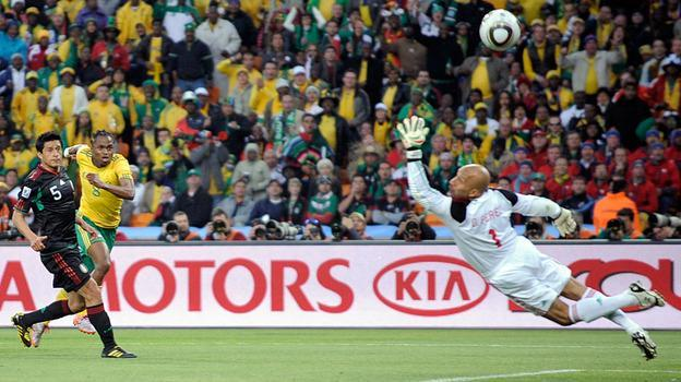 Mexico goalkeeper Oscar Perez fails to block the opening goal by South Africa's Siphiwe Tshabalala, second from left, during the World Cup opening match between South Africa and Mexico in Johannesburg, South Africa. (AP)