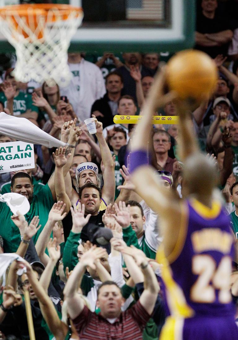 Celtics fans try to distract LA Lakers guard Kobe Bryant as he shoots a free throw during Game 5 of the NBA finals on Sunday. (AP)