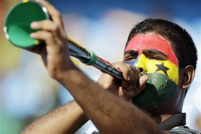 A soccer fan blows the vuvuzela prior to the World Cup soccer match between Serbia and Ghana in Pretoria, South Africa. (AP)