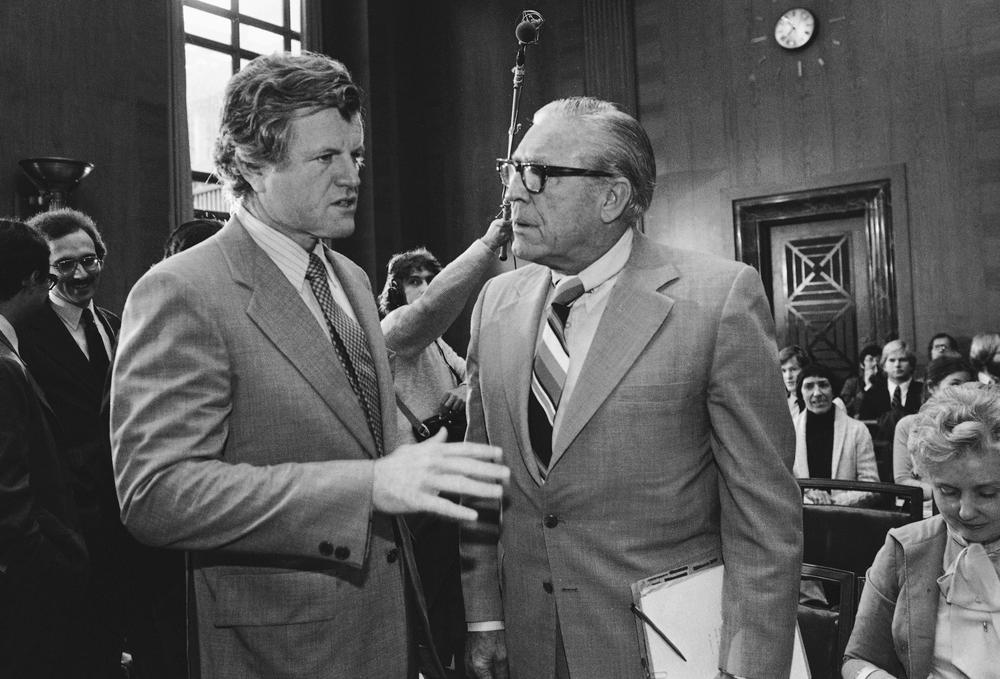 Sen. Kennedy, then Senate Judiciary Committee chairman, speaks with former FBI Director Clarence Kelly prior to hearings on the 1979 FBI Charter Act. (AP)