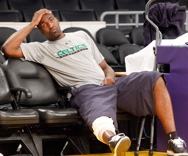 Boston Celtics' Kendrick Perkins, who injured his knee in Game 6, sits out of practice Wednesday in LA. (AP)