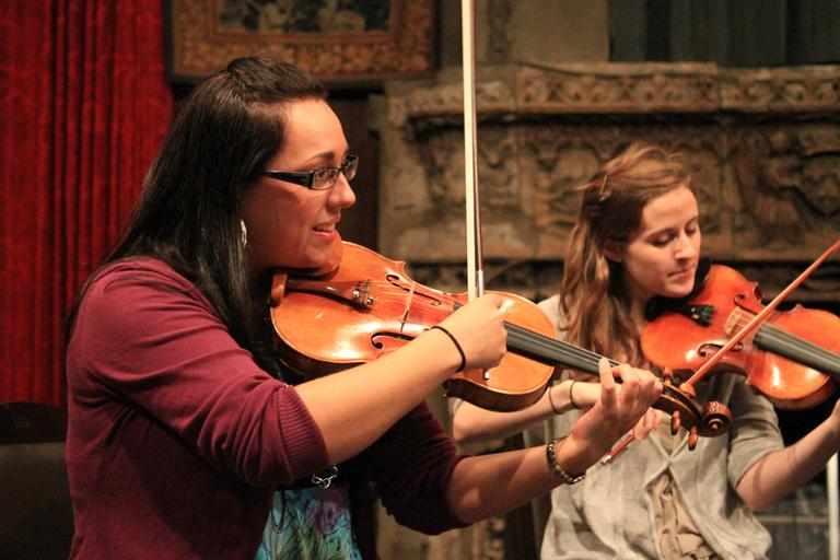 Ivonne Hernandez, left, a founding member of Chambergrass, plays the violin. (Jeff Carpenter for WBUR)