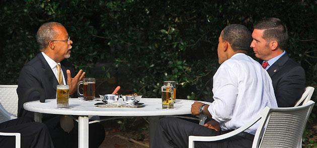 The arrest of Harvard scholar Henry Louis Gates Jr., left, sparked a national debate about race and the police. In this July 30, 2009, file photo, Gates drinks a beer with President Obama and Sgt. James Crowley, the arresting Cambridge police officer. (Alex Brandon/AP)