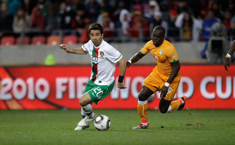 Portugal's Deco, left, and Ivory Coast's Cheick Tiote during their World Cup Group G match on Tuesday. The match ended 0-0 to the consternation of many watchers. (AP)