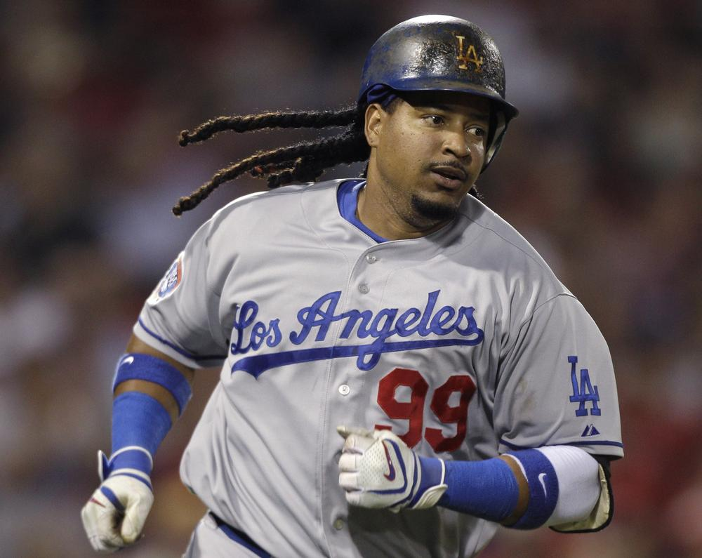 Manny Ramirez runs down the first base line on a single during the sixth inning at Fenway Park , Friday. (AP Photo/Charles Krupa)