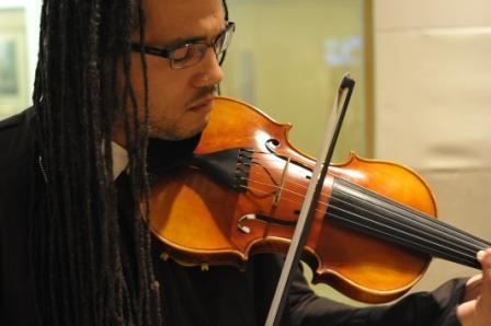 Violinist Daniel Bernard Roumain at WBUR studios in Boston. (Doug Shugarts)