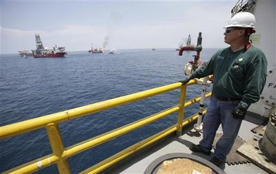 BP Wellsite Leader Mickey Fruge stands on the deck of the Development Driller II, which is drilling a relief well at the site of the Deepwater Horizon oil spill in the Gulf of Mexico off the coast of Louisiana. (AP)