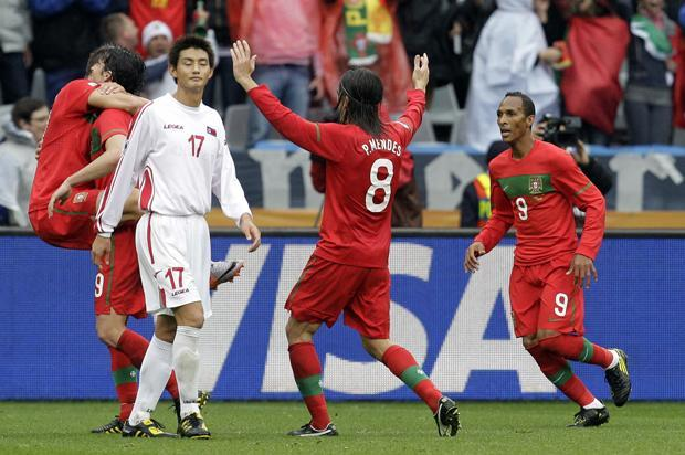 Portugal celebrates after scoring as North Korea's An Yong Hak, walks past during the World Cup group G match between Portugal and North Korea in Cape Town, South Africa on Monday. Portugal won 7-0. (AP)