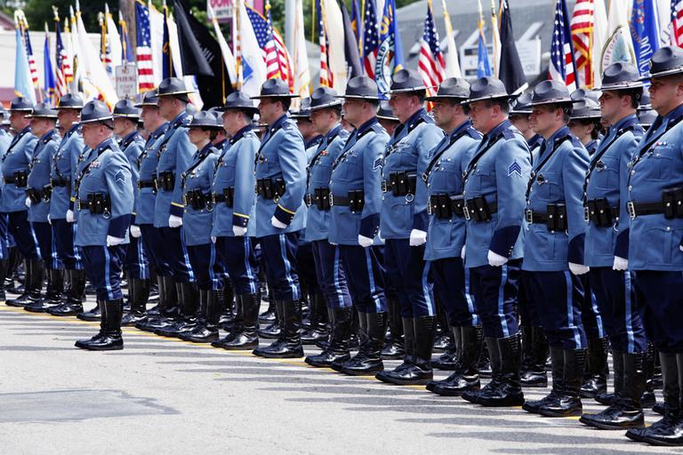 Massachusetts State Police stand at attention during the funeral for State Police Sgt. Doug Weddleton. (AP)