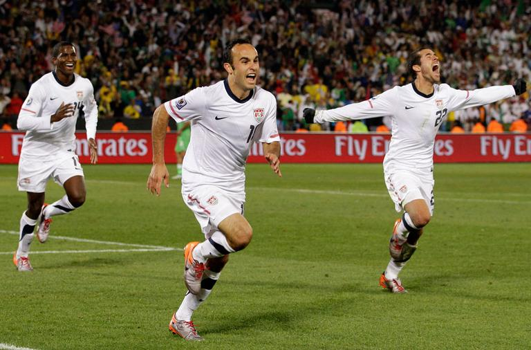 United States' Landon Donovan, center, celebrates after scoring a goal with team members Benny Feilhaber, right, and Edson Buddle, left, during a match against Algeria in Pretoria, South Africa, on Wednesday. (AP)
