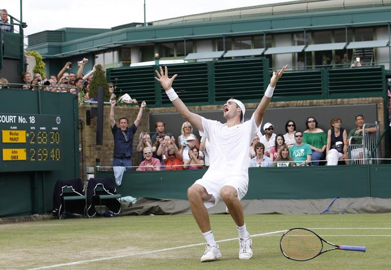 John Isner of the US reacts as he defeats France's Nicolas Mahut, in their epic men's singles match at the All England Lawn Tennis Championships at Wimbledon, Thursday, June 24, 2010. (AP)