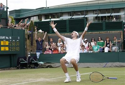 John Isner of the U.S. reacts as he defeats France's Nicolas Mahut, in their epic men's singles match at the All England Lawn Tennis Championships at Wimbledon. (AP)