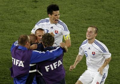 Slovakia's Marek Hamsik, top left, and Slovakia's Miroslav Stoch, right, celebrate with team members after winning the World Cup group F soccer match between Slovakia and Italy at Ellis Park Stadium in Johannesburg, South Africa. (AP)