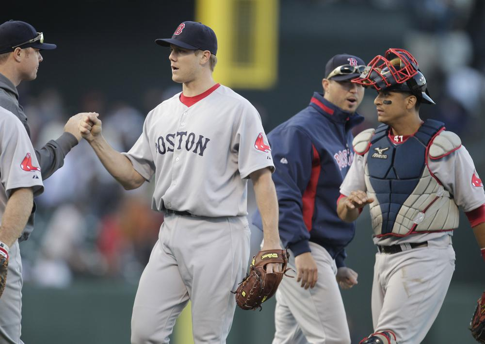 Sox relief pitcher Jonathan Papelbon, left, and catcher Victor Martinez, right, celebrate with teammates after a 4-2 victory against the Giants on Saturday. (AP)