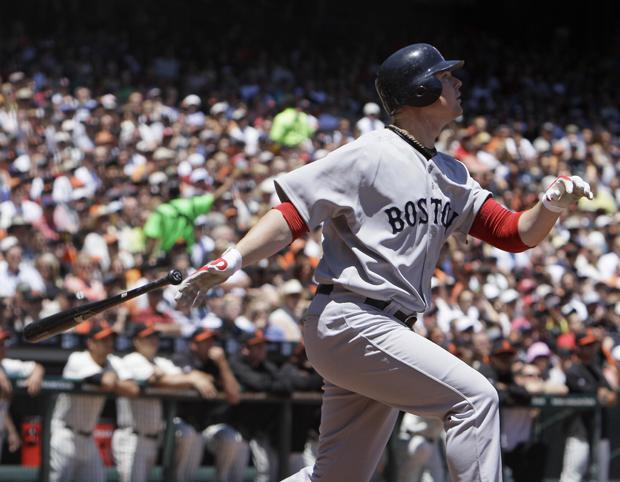 Boston's Jon Lester hits an RBI sacrifice fly off San Francisco starting pitcher Tim Lincecum during the second inning of the game in San Francisco on Sunday. Lester was the Red Sox starting pitcher in the game. (AP)