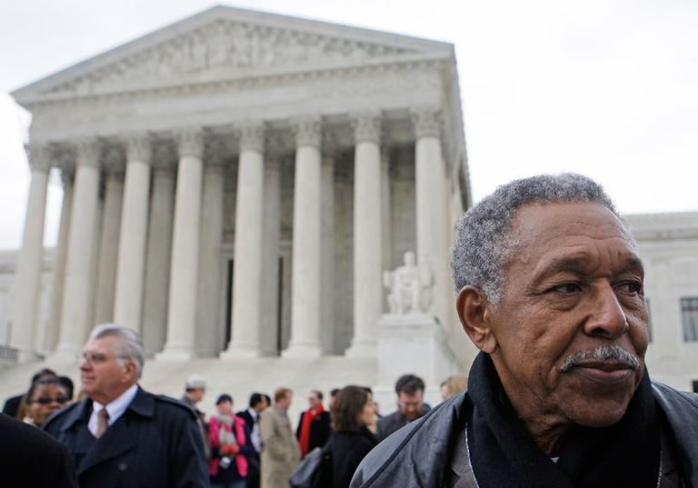 Otis McDonald, right, one of four plaintiffs in the Chicago handgun ban, takes part in a news conference in front of the Supreme Court in Washington on March 2. McDonald said he joined a federal lawsuit to challenge Chicago's 28-year-old handgun ban because he wants a handgun at home to protect himself from gangs. (AP)