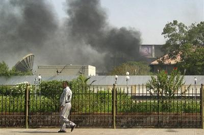 Black smoke was recently seen coming from the intelligence services building that came under attack in the southern port city of Aden, in Yemen. (AP)