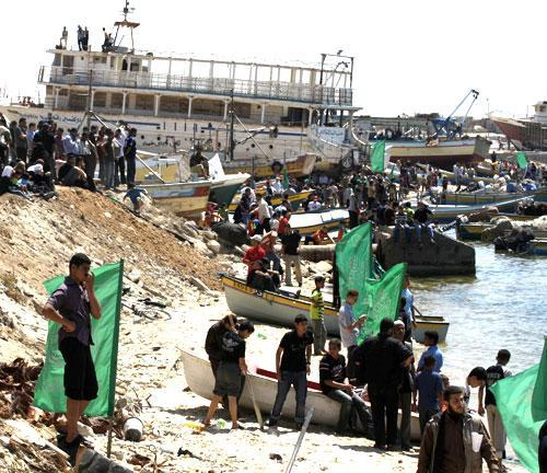 Palestinian Hamas supporters gather in Gaza's seaport to protest Israel's interception of Gaza-bound ships near the seaport in Gaza City, Monday, May 31, 2010. (AP)