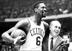 """The Boston Celtics' Bill Russell with coach """"Red"""" Auerbach at the Boston Garden, 1964. (AP)"""