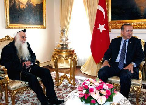 Turkey's Prime Minister Tayyip Erdogan, right, meets with Israeli cleric and peace activist Menachem Froman in Ankara, Turkey, Thursday, June 3, 2010. (AP)