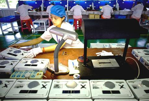 A Chinese worker checks solar-powered products at a factory in Baoding, north China's Hebei province, in 2009. (AP)