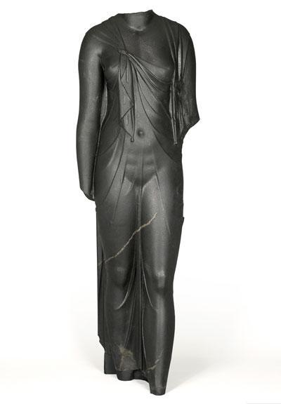 Cut in hard, dark stone, this feminine body has a startlingly sculptural quality. Complete, it must have been slightly larger than life-size. The statue is certainly one of the queens of the Ptolemaic dynasty (likely Arsinoe II) dressed as the goddess Isis, as confirmed by the knot that joins the ends of the shawl the woman wears, which was representative of the queens during this time period. The statue was found at the site of Canopus. (Credit: Franck Goddio / Hilti Foundation)