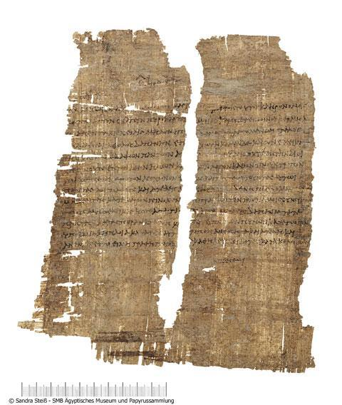 """This papyrus document, signed by Cleopatra, grants tax exemption from sales of imported wine to the Roman businessman Publius Canidius, a friend of Mark Antony. The manuscript, intended for an official in the Egyptian bureaucracy, was prepared by a court scribe. At the bottom of the document, in a rare example of her handwriting, Cleopatra herself added the Greek word """"ginesthoi,"""" """"make it happen."""" (Credit: Agyptisches Museum und Papyrussammlung)"""