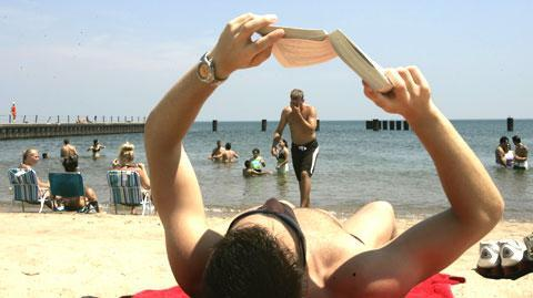 A reader on the beach along Lake Michigan. (AP)