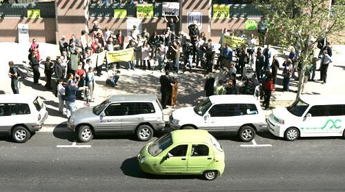 A small electric car passes other electric vehicles parked at a rally in support of electric vehicles outside the California Environmental Protection Agency in Sacramento, Calif. (AP)