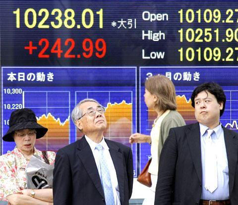 The view before a stock price indicator in Tokyo, June 21, 2010. (AP)